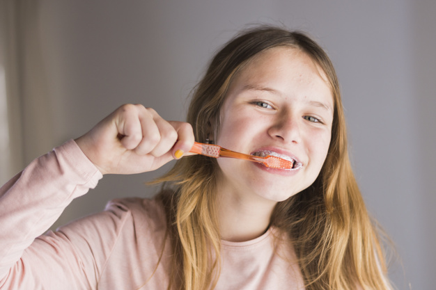 close-up-of-a-girl-brushing-teeth-with-toothbrush_23-2147873766